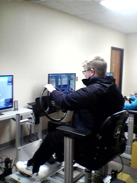 10th grader, Matthew Cook using simulator machine.