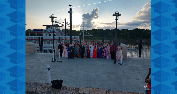 ALVA Students next to riverboat prom